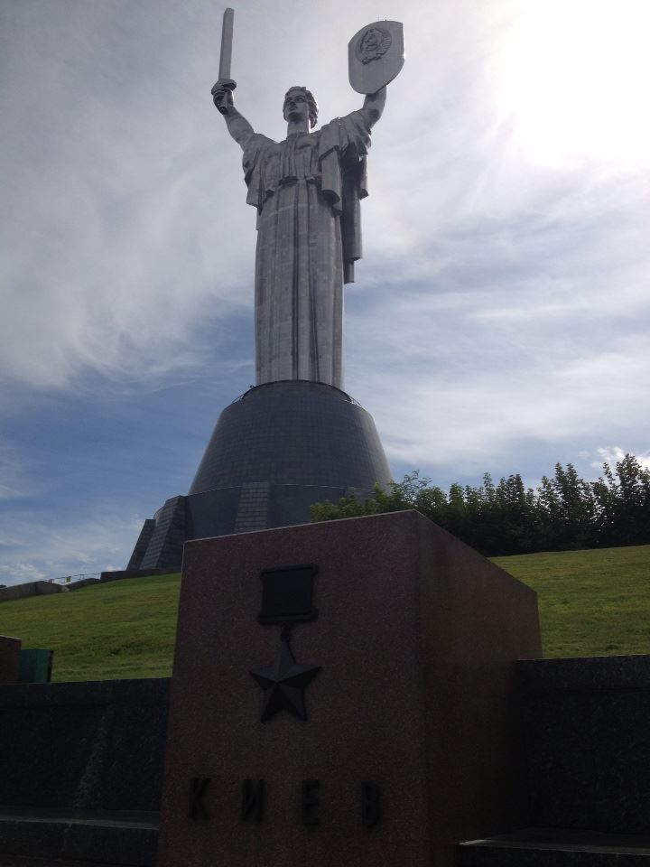 """The Rodina Mat (""""Mother Motherland"""" statue towers above the """"Hero City"""" memorial plaque for Kyiv's defense against the Germans during WWII."""